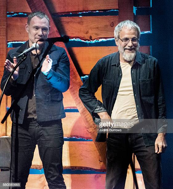 Singer David Gray applauds after presenting the Lifetime Achievement award to British singersongwriter Yusuf Islam at the 16th annual BBC Radio 2...