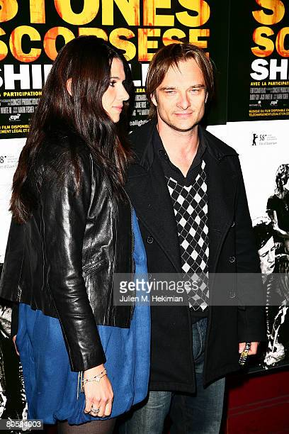 Singer David Hallyday and his wife Alexandra arrive at the Shine a Light Paris premiere at the Olympia on April 09 2008 in Paris France