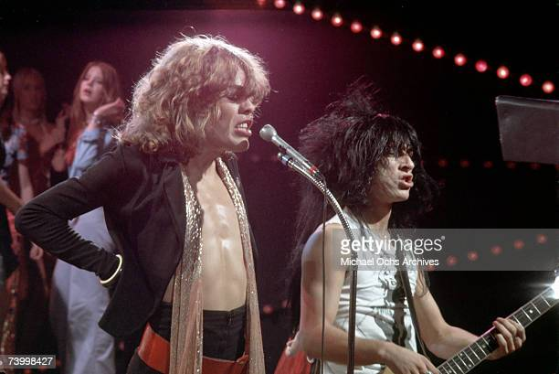 Singer David Johansen guitarist Johnny Thunders of the rock and roll group 'The New York Dolls' pose for a portrait with host Don Steele on 'The Real...