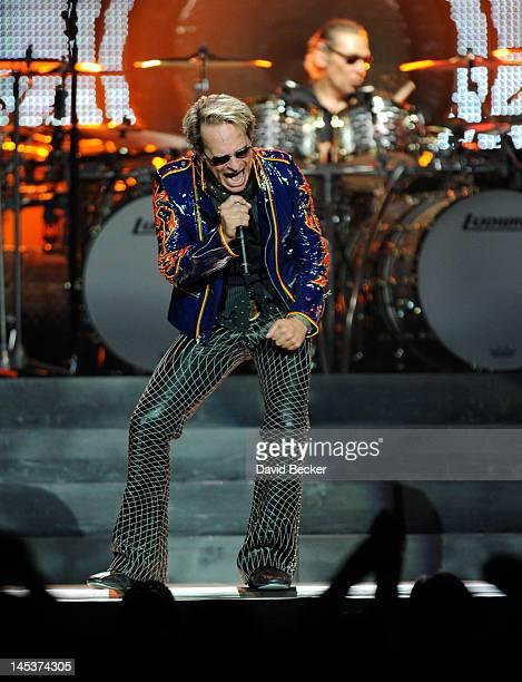 Singer David Lee Roth and drummer Alex Van Halen of Van Halen perform at MGM Grand Garden Arena on May 27 2012 in Las Vegas Nevada