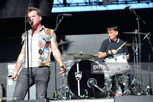 Singer David Roach and drummer Patrick Muzingo of Junkyard perform onstage at the Cathouse Festival at Irvine Meadows Amphitheatre on August 15 2015...