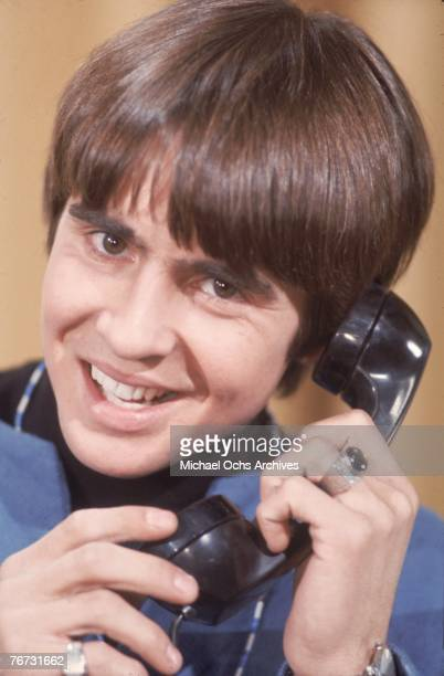 Singer Davy Jones from the pop band The Monkees poses for a portrait holding a telephone in December1967