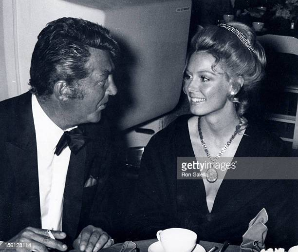 Singer Dean Martin and actress Julie Bowen attending the premiere of 'Airport' on March 19 1970 at the Hollywood Pacific Theater in Hollywood...