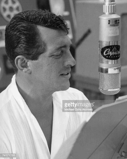 Singer Dean Martin records song in the Capital Records Recording Studio in Los Angeles California circa 1956