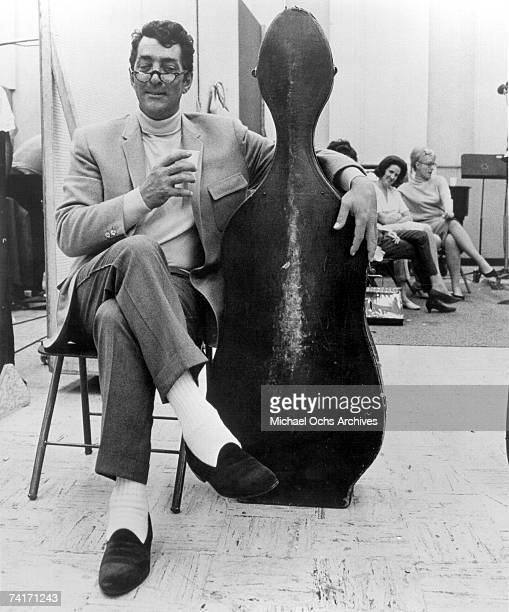 Singer Dean Martin takes a break from recording in a Los Angeles California recording studio circa 1964