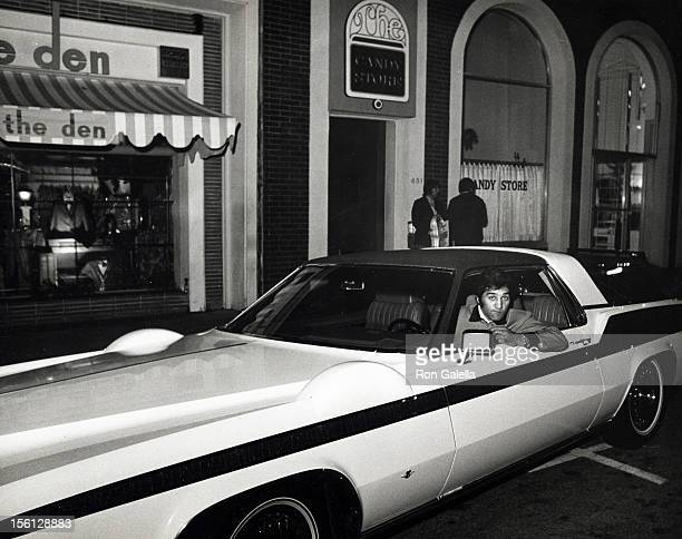 Singer Dean Martin's car and driver outside The Candy Store on May 1 1970 in Beverly Hills California
