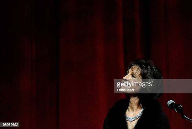 Singer Deana Martin, daughter of Dean Martin, watches video clips of her father during a Las Vegas Walk of Stars dedication ceremony for...
