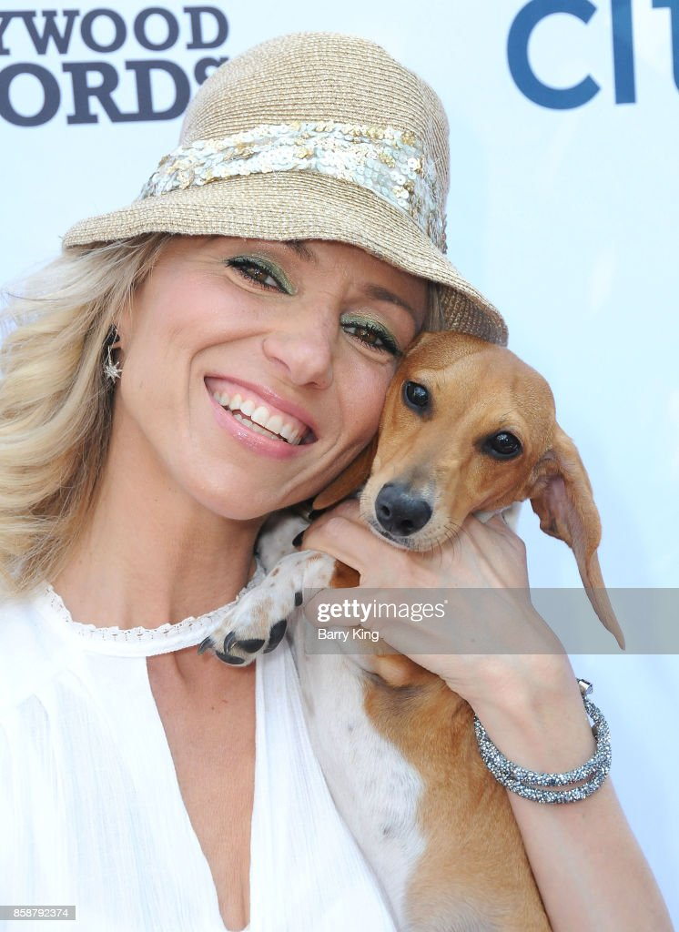 Singer Debbie Gibson and her dog Joey attend T.J. Martell Foundation Family Day at The Grove on October 7, 2017 in Los Angeles, California.