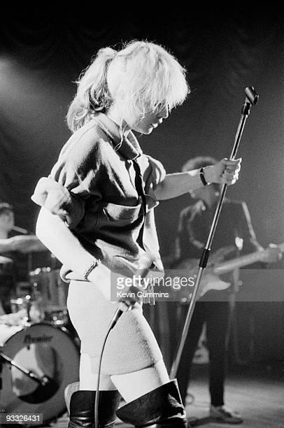 Singer Debbie Harry of American band Blondie wearing shorts and thigh high boots performs on stage at King George's Hall in Blackburn on February 23...