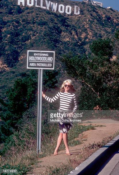 Singer Debbie Harry of the New Wave pop group 'Blondie' poses for a portrait in March 1977 on a hill beneath the Hollywood Sign in Los Angeles...