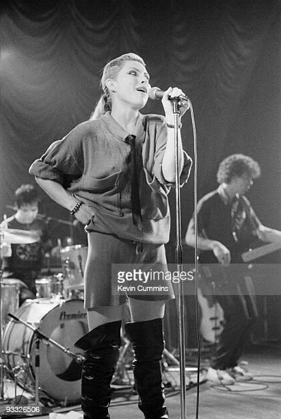 Singer Debbie Harry with drummer Clem Burke and bassist Nigel Harrison of American band Blondie perform on stage at King George's Hall in Blackburn...