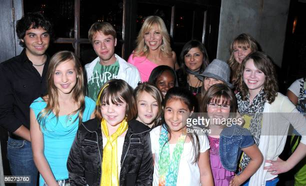 Singer Deborah Gibson poes with the kids from her camp at An Evening of Electric Youth to Benefit Gibson Girl held at Cafe La Boheme on April 28 2009...