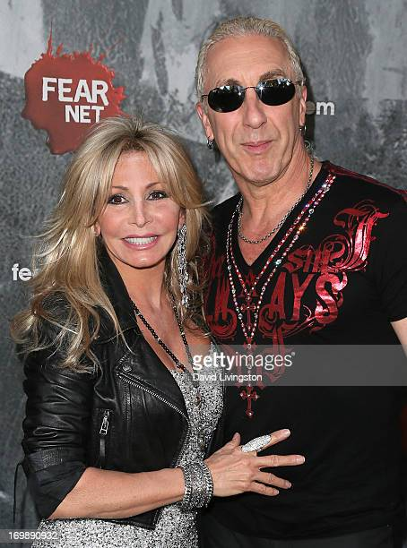 Singer Dee Snider and wife Suzette Snider attend the premiere of FEARnet's Holliston at Cinefamily on June 3 2013 in Los Angeles California