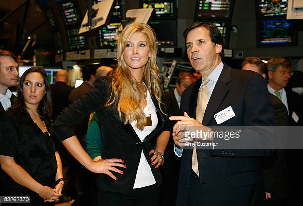 Singer Delta Goodrem and Senior Vice President of the Global Corporate Client Group for the New York Stock Exchange Thomas Veit attend the opening...