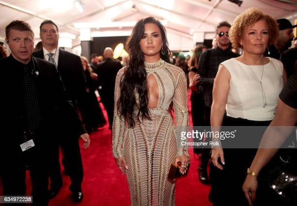 Singer Demi Lovato and CEO of BET Debra L Lee attend The 59th GRAMMY Awards at STAPLES Center on February 12 2017 in Los Angeles California
