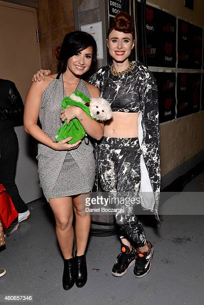 Singer Demi Lovato and Kiesza attend 1035 KISS FM's Jingle Ball 2014 at Allstate Arena on December 18 2014 in Chicago Illinois