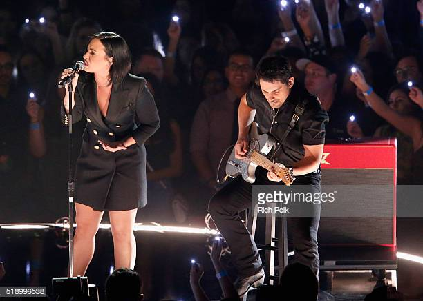 Singer Demi Lovato and musician Brad Paisley perform onstage during the iHeartRadio Music Awards at The Forum on April 3 2016 in Inglewood California