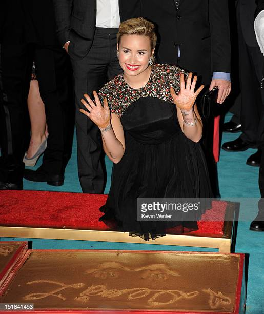 Singer Demi Lovato appears at the premiere of Fox's The X Factor Season 2 and handprint ceremony at the Chinese Theatre on September 11 2012 in Los...