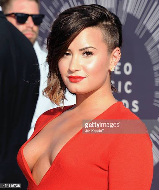 Singer Demi Lovato arrives at the 2014 MTV Video Music Awards at The Forum on August 24, 2014 in Inglewood, California.