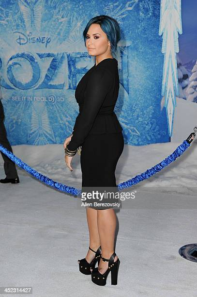 Singer Demi Lovato arrives at the Los Angeles premiere of Disney's Frozen at the El Capitan Theatre on November 19 2013 in Hollywood California