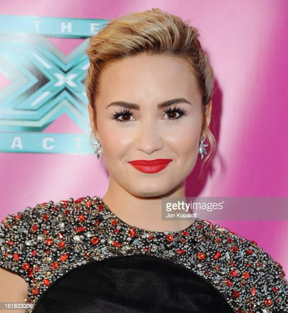 """Singer Demi Lovato arrives at """"The X Factor"""" Season Two Premiere at Grauman's Chinese Theatre on September 11, 2012 in Hollywood, California."""