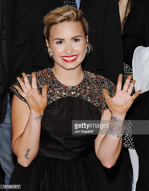 Singer Demi Lovato arrives at The X Factor Season Two Premiere at Grauman's Chinese Theatre on September 11 2012 in Hollywood California