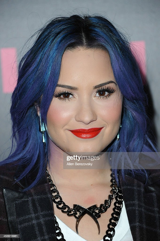 Singer Demi Lovato attends NYLON Magazine's December Issue Celebration of her cover at Smashbox West Hollywood on December 5, 2013 in West Hollywood, California.