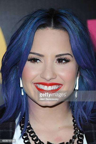 Singer Demi Lovato attends NYLON Magazine's December Issue Celebration of her cover at Smashbox West Hollywood on December 5 2013 in West Hollywood...