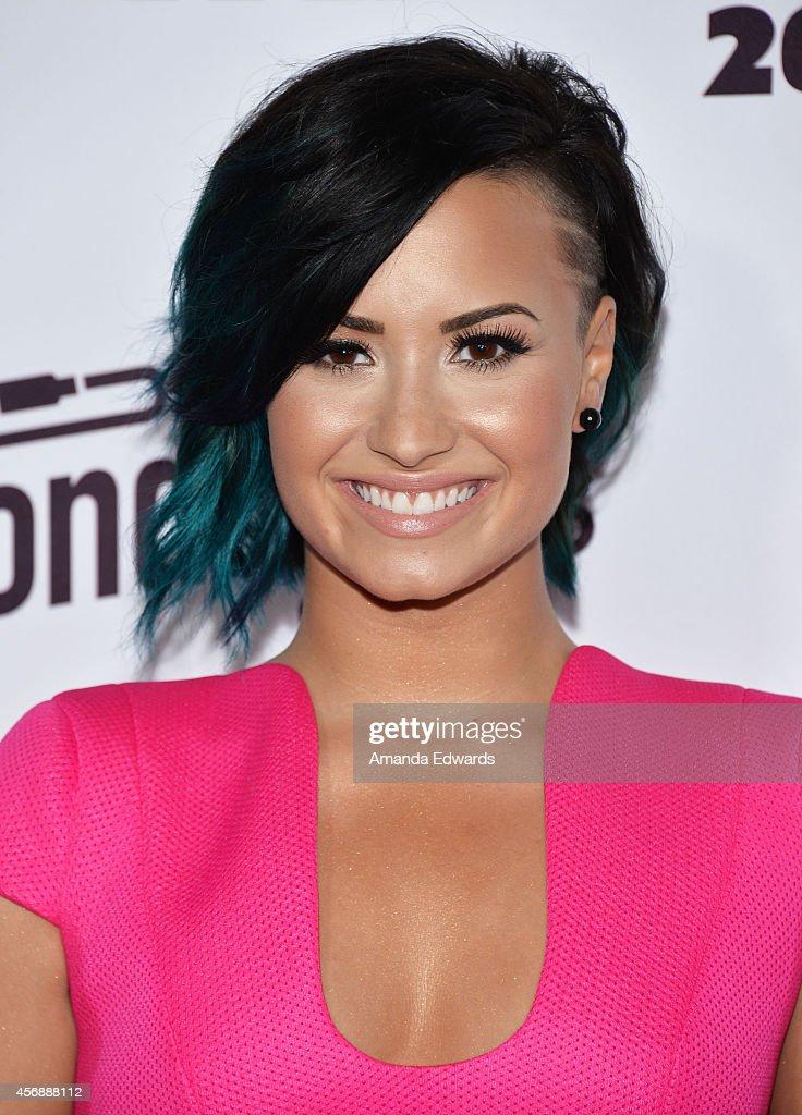 Singer Demi Lovato attends the Vevo CERTIFIED SuperFanFest presented by Honda Stage at Barkar Hangar arrives at the at Barker Hangar on October 8, 2014 in Santa Monica, California.