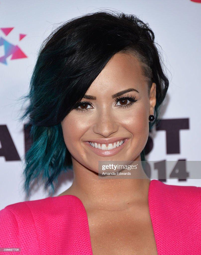 Singer Demi Lovato attends the Vevo CERTIFIED SuperFanFest presented by Honda Stage at Barkar Hangar on October 8, 2014 in Santa Monica, California.
