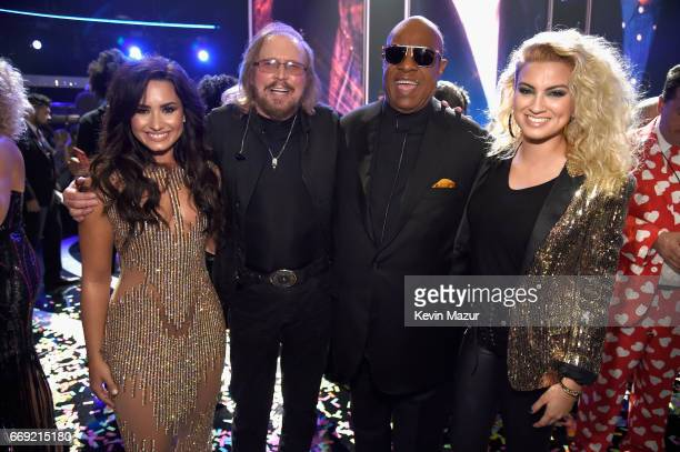 Singer Demi Lovato honoree Barry Gibb of the Bee Gees and singers Stevie Wonder and Tori Kelly during 'Stayin' Alive A GRAMMY Salute To The Music Of...