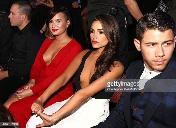Singer Demi Lovato Olivia Culpo and singer Nick Jonas attend the 2014 MTV Video Music Awards at The Forum on August 24 2014 in Inglewood California