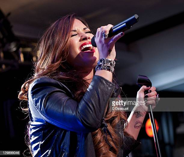 Singer Demi Lovato performs on stage at Z100's Jingle Ball '11 official kick off party at Aeropostale Times Square on October 21 2011 in New York City