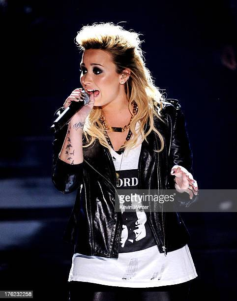 Singer Demi Lovato performs onstage at the Teen Choice Awards 2013 at the Gibson Amphitheatre on August 11 2013 in Universal City California