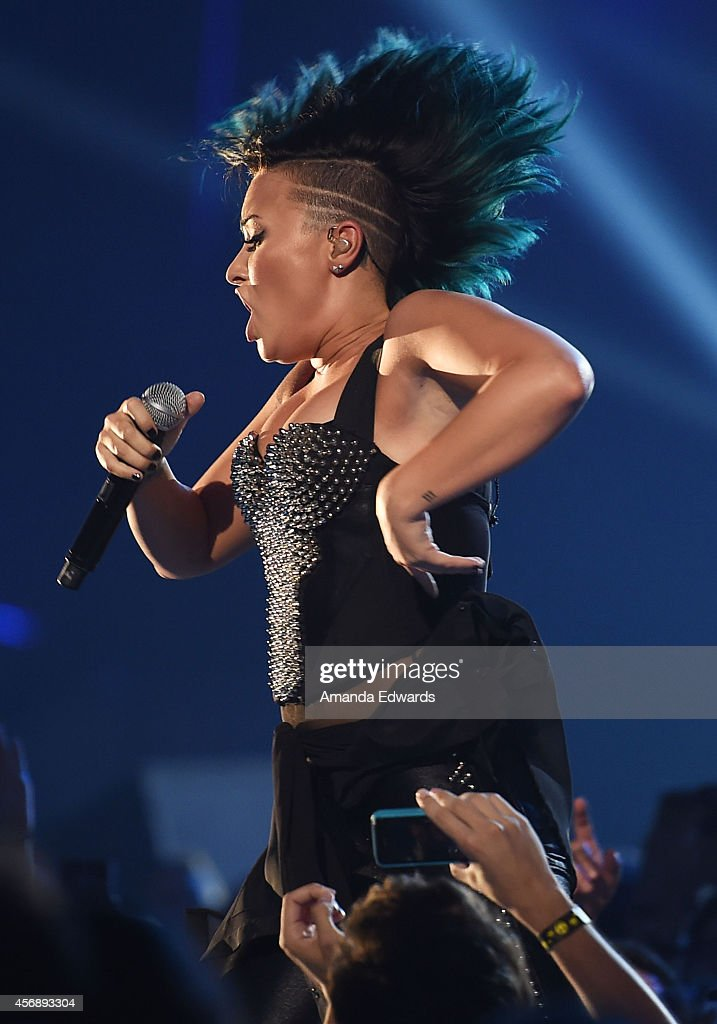 Singer Demi Lovato performs onstage during the Vevo CERTIFIED SuperFanFest presented by Honda Stage at Barkar Hangar on October 8, 2014 in Santa Monica, California.