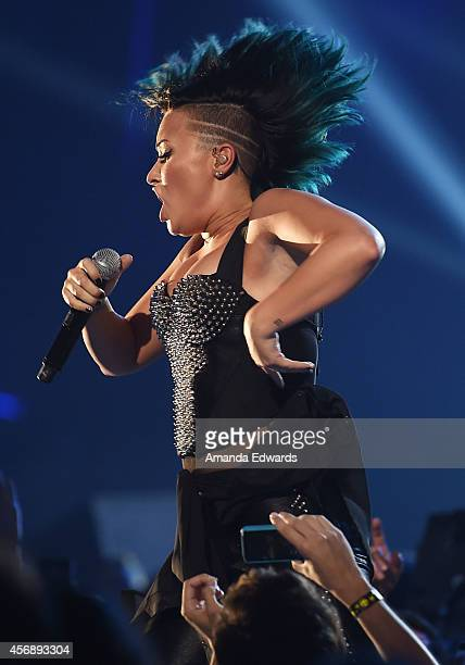 Singer Demi Lovato performs onstage during the Vevo CERTIFIED SuperFanFest presented by Honda Stage at Barkar Hangar on October 8 2014 in Santa...