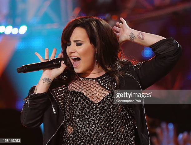Singer Demi Lovato performs onstage during VH1 Divas 2012 at The Shrine Auditorium on December 16 2012 in Los Angeles California