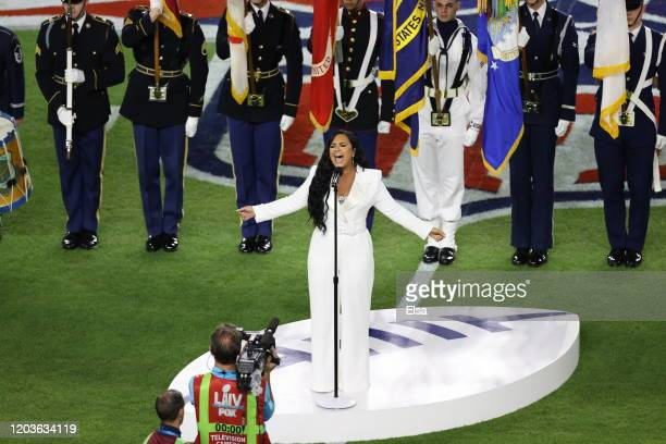 Singer Demi Lovato performs the national anthem prior to Super Bowl LIV between the San Francisco 49ers and the Kansas City Chiefs at Hard Rock...