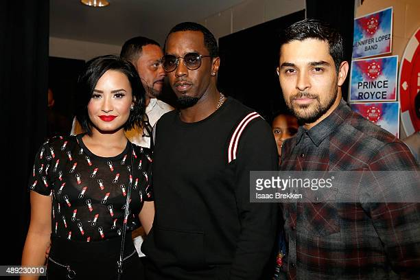 Singer Demi Lovato rapper Sean 'Diddy' Combs and actor Wilmer Valderrama attend the 2015 iHeartRadio Music Festival at MGM Grand Garden Arena on...