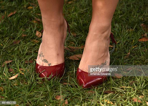 Singer Demi Lovato shoe and tattoo detail attends the photo call for Sony Pictures Releasing's Smurfs The Lost Village at Sony Pictures Studios on...