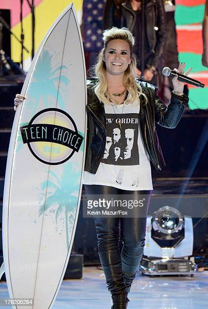 Singer Demi Lovato speaks onstage at the 2013 Teen Choice Awards at Gibson Amphitheatre on August 11, 2013 in Universal City, California.