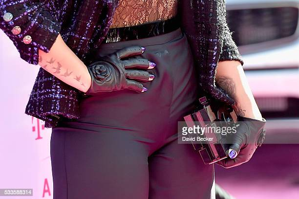Singer Demi Lovato tattoo and fashion detail attends the 2016 Billboard Music Awards at TMobile Arena on May 22 2016 in Las Vegas Nevada