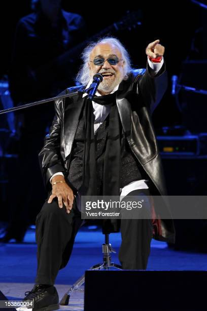 Singer Demis Roussos performs on stage at Istiqlol Palace on October 9 2012 in Tashkent Uzbekistan