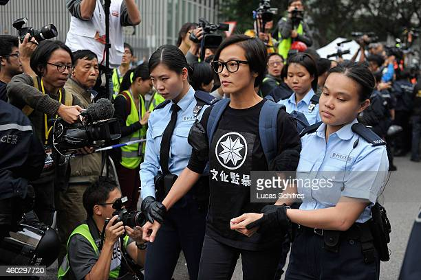 Singer Denise Ho is being arrested and escorted by police officers during the clearance of Occupy Central Pro-democracy camp in Admirality, on...