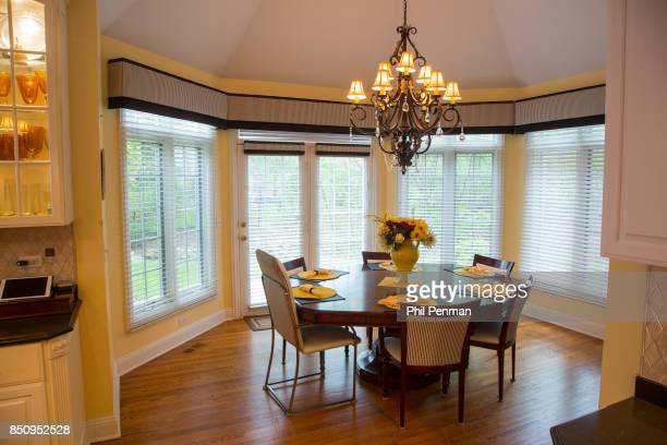 Singer Dennis DeYoung's home is photographed for Closer Weekly Magazine on April 26 2016 in Illinois DeYoung chose the eightsided dining table...