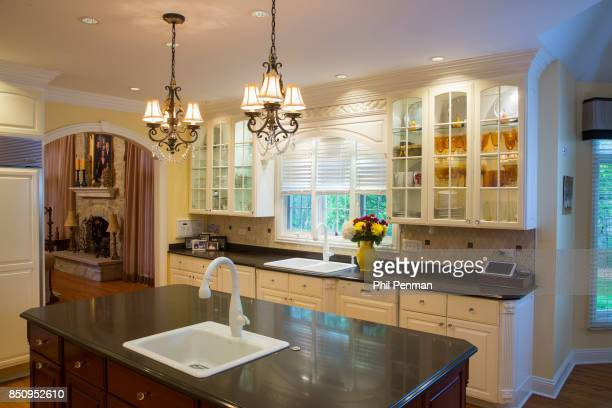 Singer Dennis DeYoung's home is photographed for Closer Weekly Magazine on April 26 2016 in Illinois Kitchen features crystal cabinet knobs and...