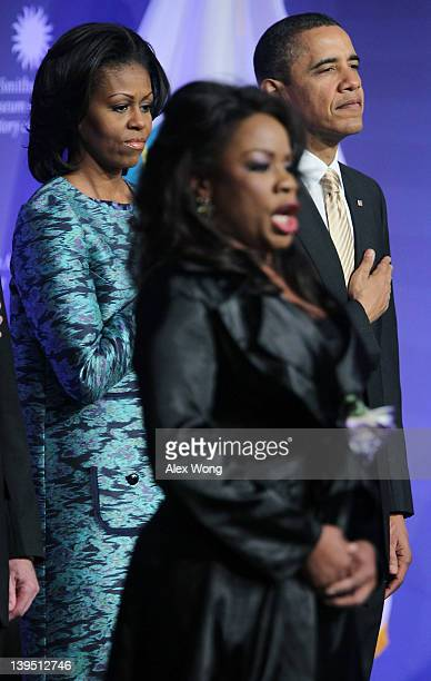 Singer Denyce Graves sings the national anthem as US President Barack Obama and first lady Michelle Obama listen during the groundbreaking ceremony...