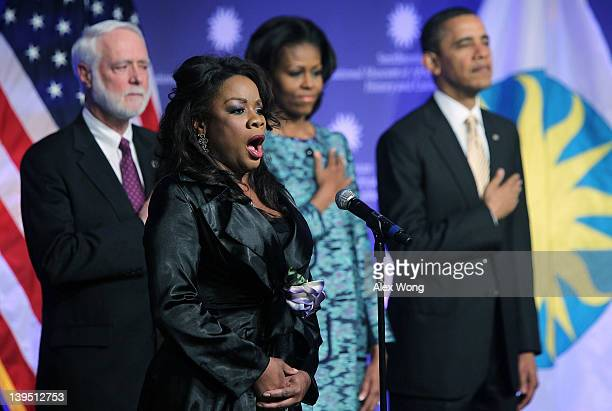 Singer Denyce Graves sings the national anthem as US President Barack Obama first lady Michelle Obama and Smithsonian Secretary Wayne Clough listen...