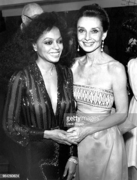 Singer Diana Ross and actress Audrey Hepburn attend an awards ceremony circa 1980s