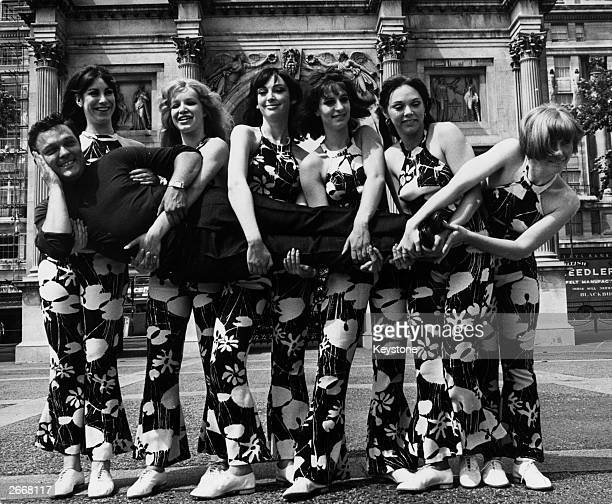Singer Dickie Valentine being carried by the girls who are to appear in 'The Dickie Valentine Show' The girls who are all dancers are l to r Diane...